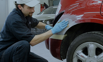 Maaco: Employee performing collision repair